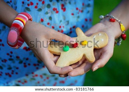 Woman with cookies  man in the hands of - stock photo