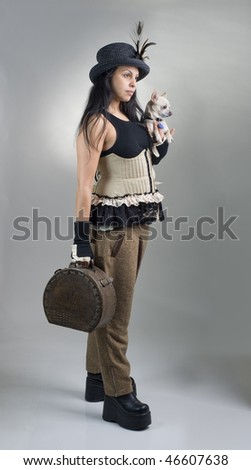 woman with corset breeches hat dog and bag