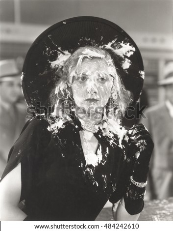 Woman with cream pie thrown in her face