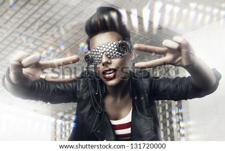 woman with creative sunglasses and architecture - stock photo