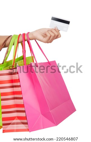 Woman with credit card and  shopping bags  isolated on white background
