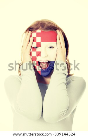 Woman with croatia flag painted on face. - stock photo