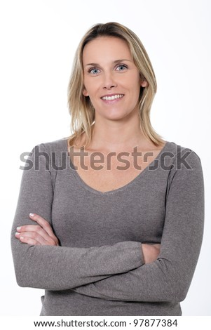 woman with crossed arms isolated over a white background - stock photo