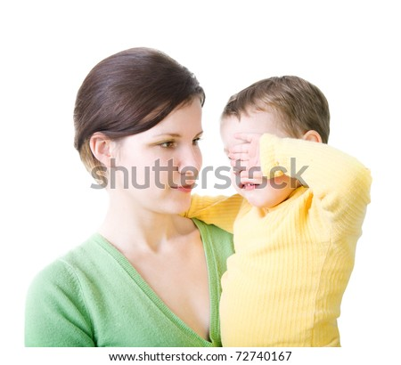 Woman with crying child - stock photo