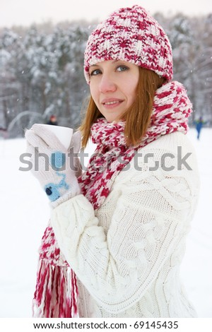 Woman with cup in winter