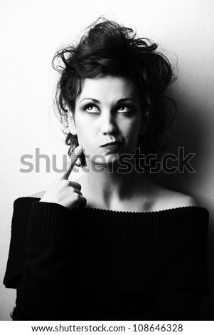Woman with curly stylish hairstyle thinking.