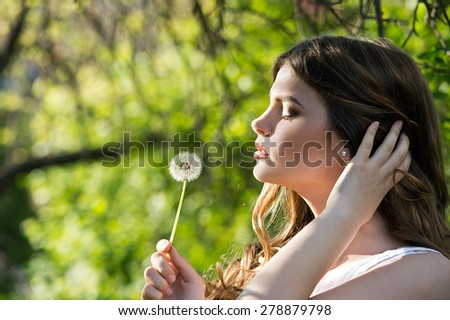 woman with dandelion on sunny day  - stock photo