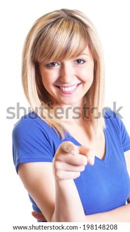 Woman with dark eyes and blue shirt pointing at camera - stock photo