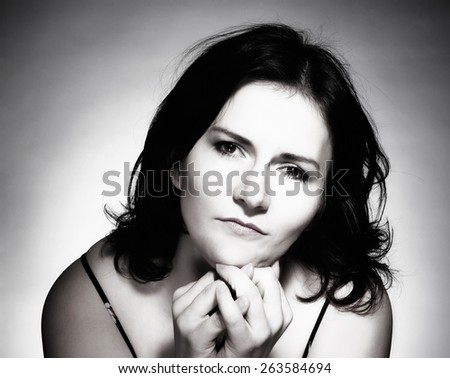 Woman with Dark Hair Looking, Thinking - stock photo