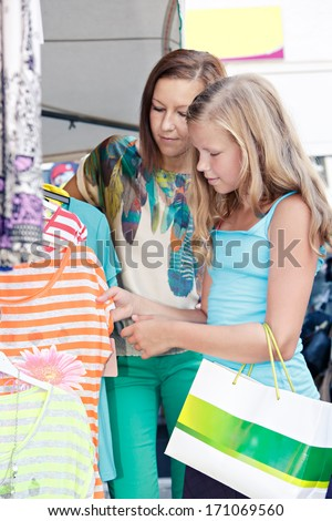 woman with daughter shopping in an european city - stock photo
