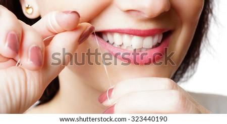 Woman with dental floss  - stock photo