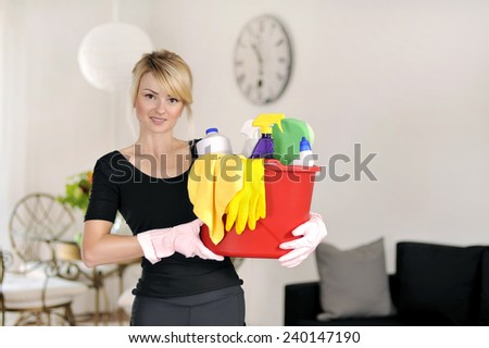 Woman with detergent for clean house  - stock photo