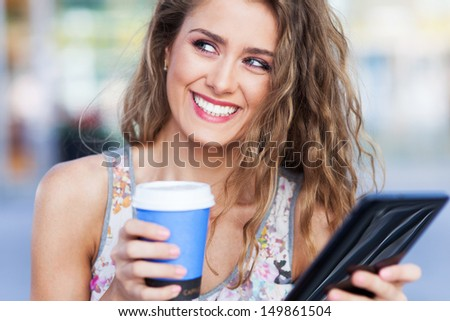 Woman with digital tablet and coffee - stock photo