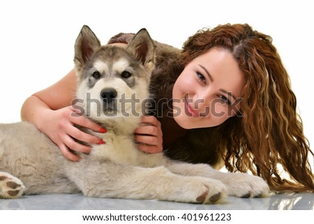 woman with dog Alaskan malamute