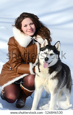 Woman with dog Husky in the winter - stock photo