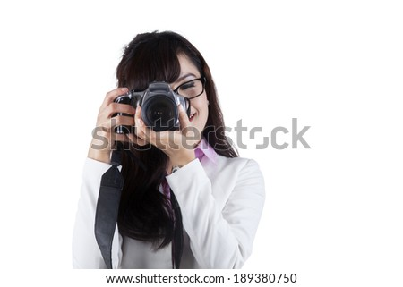 Woman with DSLR camera over white background - stock photo