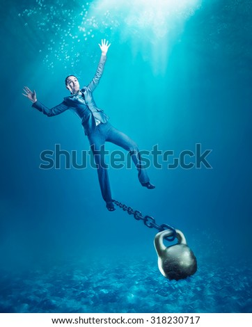 Woman with dumb-bell sinking