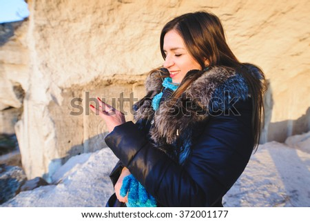 woman with engagement ring in cave