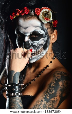 Woman with face-art of scull