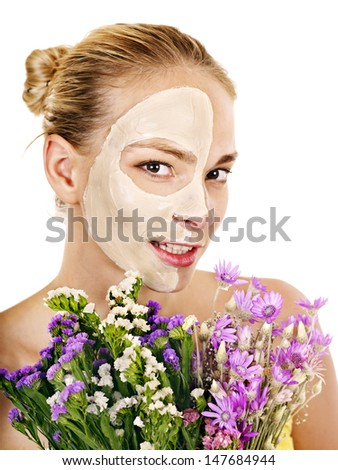 Woman  with facial mask  holding flower. Isolated.