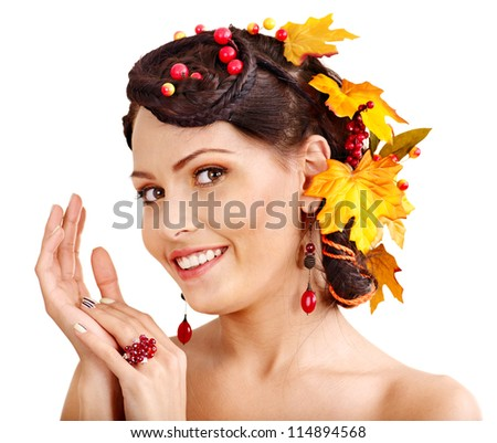 Woman with fall hairstyle and make up.