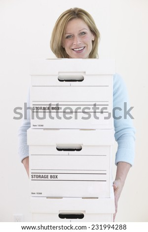 Woman with File Boxes - stock photo