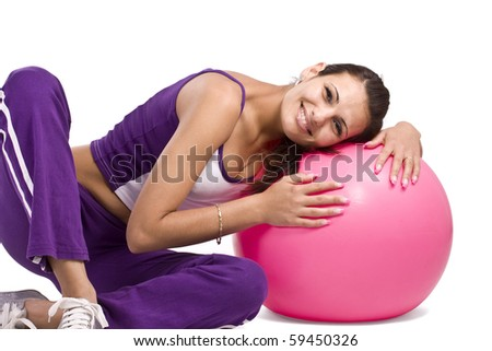Woman with fitness ball, isolated in white - stock photo