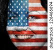 Woman with flag painted on her face to show USA support in sports - stock photo