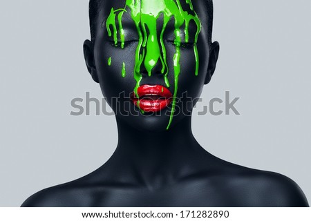woman with flowing green paint - stock photo