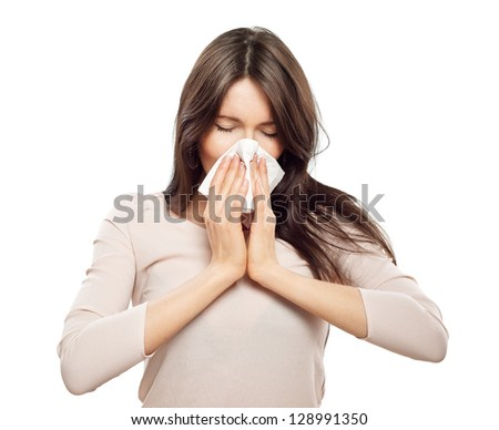 Woman with flu, holding tissue - stock photo
