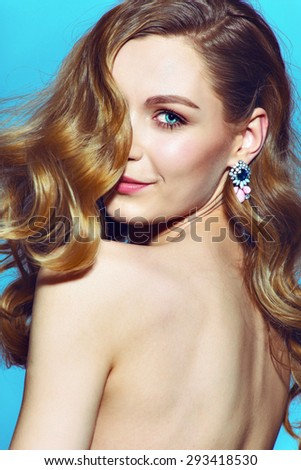 woman with fresh daily makeup and romantic wavy hairstyle. Fashion shiny highlighter on skin - stock photo