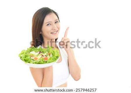 Woman with Fresh vegetable salad