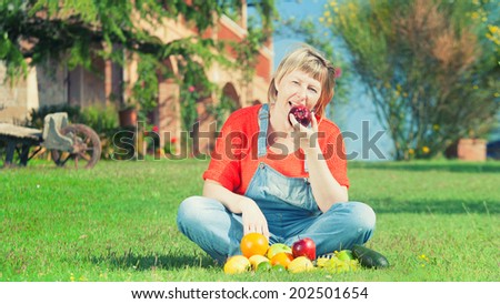 Woman with fruits on green grass