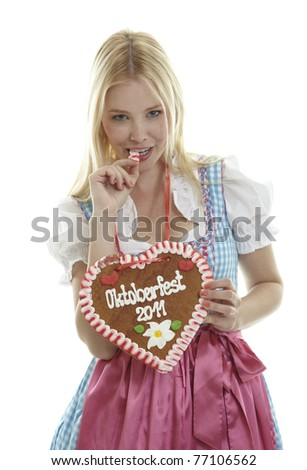 Woman with German Lebkuchen heart - stock photo