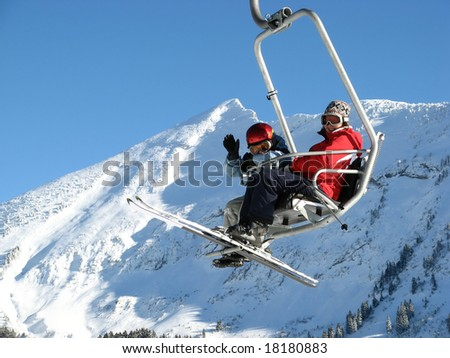 Woman with girl on the ski lift (Amden, Switzerland) - stock photo