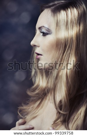 Woman with Glamour beautiful blond hair and long lashes