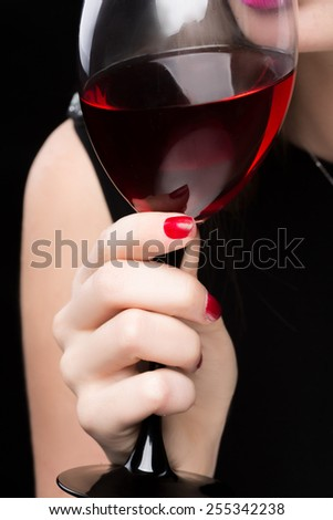 woman with glass red wine. saturated color, nails. - stock photo
