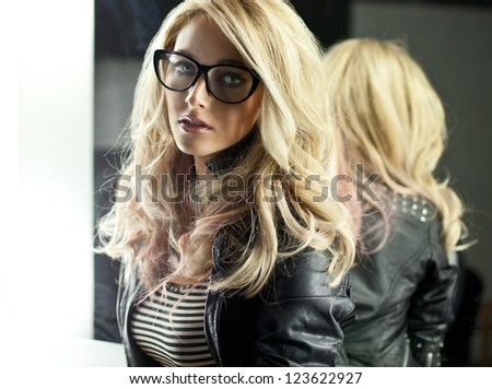 Woman with glasses in mirror