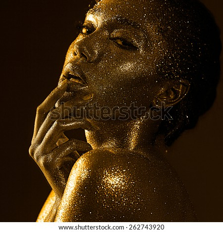 woman with glitter and spangle (shallow DOF) - stock photo