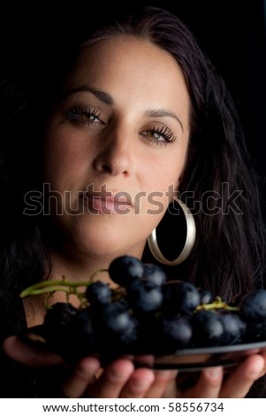 Woman with grapes - stock photo