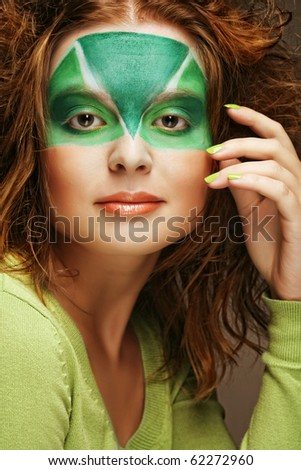 woman with green creative make-up