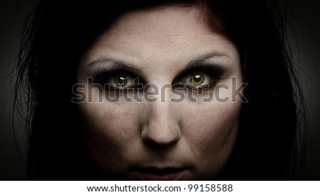 Woman with green eyes and an intense stare - stock photo