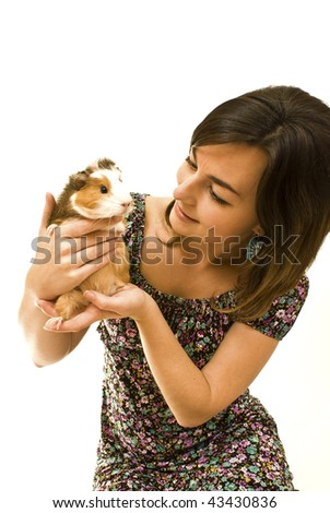 Woman with guinea pig in her hands