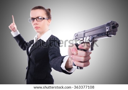 Woman with gun isolated on white - stock photo