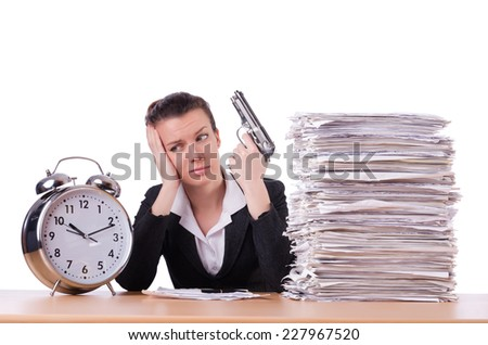 Woman with gun under stress from deadlines - stock photo