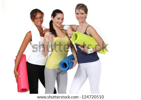 Woman with gym mats - stock photo