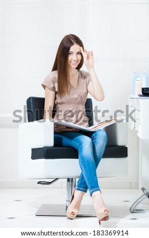 Woman with hair color samples sits in the hairdresser's. Concept of fashion and beauty - stock photo