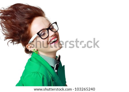 woman with hair stand on end, crazy hair, in green coat and glasses - stock photo