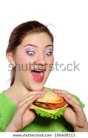 Woman with hamburger hands light background