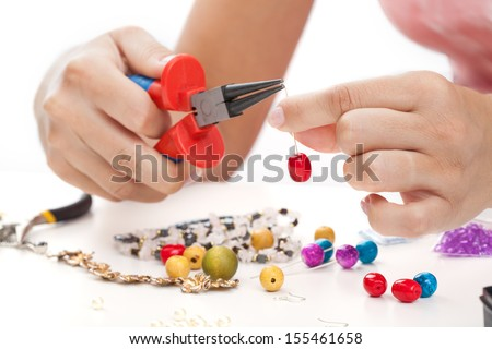 Woman with hand made jewellery on white isolated background - stock photo